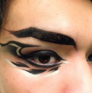 I was playing around with some gel liner and came up with this geometric design which reminded me of aztec patterns and a dragon wing