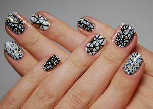 All done freehand with a little detailing brush using OPI My Boyfriend Scales Walls, American Apparel Hassid and Zoya Ziv!  http://www.dressedupnails.com/2013/03/geometric-challenge-day-10-recreate-yo.html