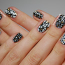 Black, white and gold geometric nails