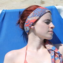 Red hair by the pool