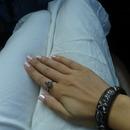 Pink nails, skull bracelet, skull ring