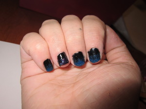 Glittery Fades :P I love glitter so i thought it would be cool to try and fade it out. 3 are blue and 1 is purple (kinda hard to tell) Thumb(next picture) is silver glitter and they all fade to black :)