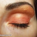 Gold and orange make up