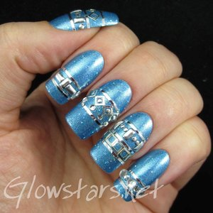Read the blog post at http://glowstars.net/lacquer-obsession/2015/04/studs-and-stripes-on-holo/