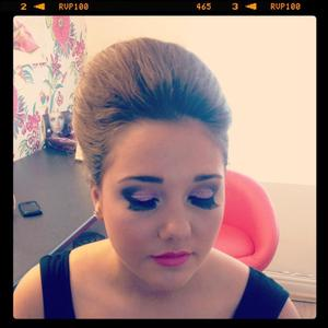 My lovely client going to prom. The hair was a beehive with twist at the back with accesories added into. The eyes are a pale pink glitter