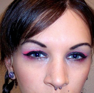 I did a super black lid, winged eyeliner and a glow of hot pink