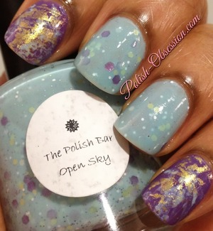 Polishes used: The Polish Bar Open Sky and NOPI I'm A Belieber, Revlon Waterfall and Beauty UK Aztec .  I wore Open Sky on my middle and ring fingers and wanted to have fun with the colors in this polish.  So I applied two coats of I'm A Belieber to my index and pinky fingers.  I then added Waterfall and Aztec with Saran Wrap to them for a fun look.  For my base I used Rejuvocote and for my top coat, I used Seche Vite Fast Dry.