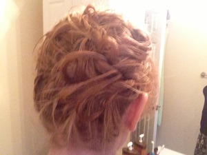 I discovered this look accidentally when a first attempt at a hairstyle fell through. Here's what I did: