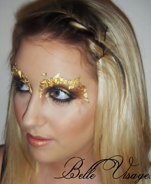 Smoky bronze/black/gold eye with gold leaf eyebrows and loads of black mascara