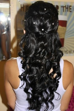 a messy yet sophisticated curly up do