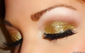 For more information on products used, please visit: http://www.vanityandvodka.com/2013/05/gold-glitter.html xoxo! -Colleen