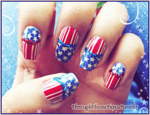 """Instead of using white, I used a nude color for a more """"vintagy"""" look.  Colors used:  American Apparel .:. California Trooper, American Apparel .:. Cameo Blue, and Zoya .:. Rehka  Plates: Mash 43 and QA18  Craft Glitter: red and blue"""