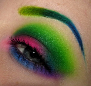 The eyebrows are Anastasia Beverly Hills HyperColor brow powders in mega watt green, teal tornado, and electric blue.