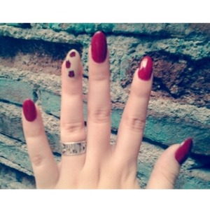 Kind of blurry, but the ring finger has red and black roses on it. :)