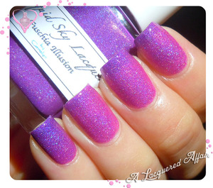 A thermal nail polish that transitions from fuschia to purple when warm and cold respectively.  Swatches and review on the blog - http://www.alacqueredaffair.com/Liquid-Sky-Lacquer-Fuschia-Illusion-30895051