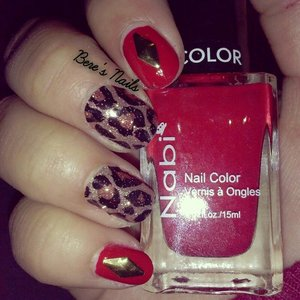 used a red base for my nail and accented them with a diamond shaped gold stud. used leopard print nail sticker for the rest of my nails to complement the rest of the mani!