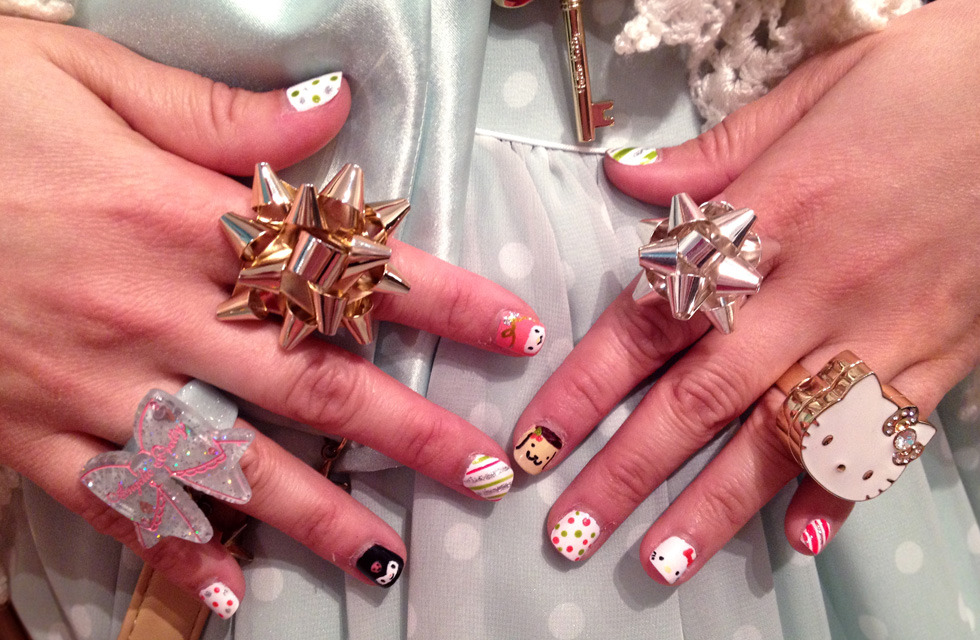 Kammie's nails remind us of Japanese Christmas candy and were hand painted by her talented sister.
