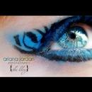 Blue zebra eye makeup.