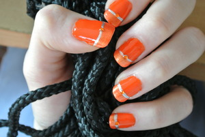 """Catchy and colorful springtime look!  I used Essie in """"Orange! It's obvious"""", Oriflame Nail Polish in """"High Voltage"""" and Oriflame Very Me Nail Art in """"Silver Lining"""" as well as Victoria Silk Touch Top Coat and orange rhinestones."""