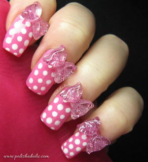 I used OPI If You Moust You Moust and Alpine Snow for this look with some pink plastic bows