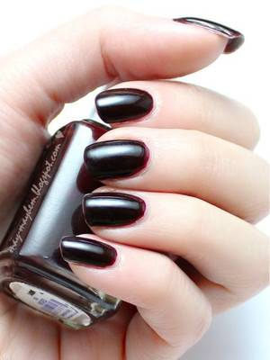 A beautiful shade which hovers over the line of red, brown and black.  The perfect nails for fall and also Halloween!