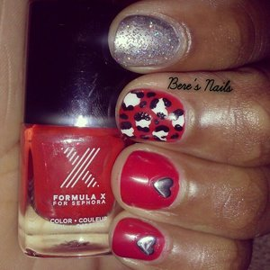 Did my friends nails with a simple valentines design. Red and silver base with a black and white leopard print accented. Added a silver heart stud to the rest of the nails. Topped the silver base with a holographic glitter.