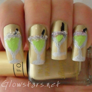 A margarita mani created using polish, freehand acrylic paint and sugar.