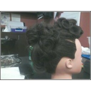 Doing an updo competition in beauty school, and I did a pinup type updo.