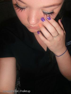 wearing false lashes.