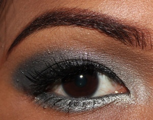 Pair Maybelline Color Tattoo in Audacious asphalt with Revon 16hour colorstay quad in Siren for this gorgeous eye.  http://chinadolltt.blogspot.com/2012/07/audacious-siren-eyes.html