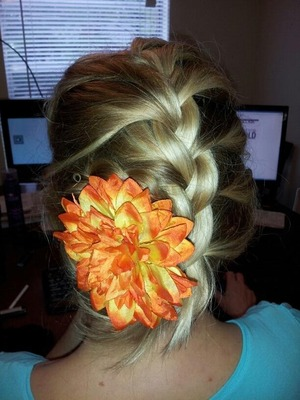 When my mom watches T.V. or is on the computer, I like to play with her hair. She does not use flowers in her hair often enough.