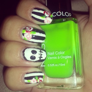 did some black and white striped nails with roses and a skull accent!