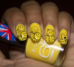 http://www.bellezzabee.com/2013/10/sunny-faces-for-sunny-days-nail-art.html