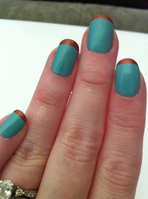 My new favorite nail look! The copper is actually shimmery orange...it just turned copper on top of the blue :)