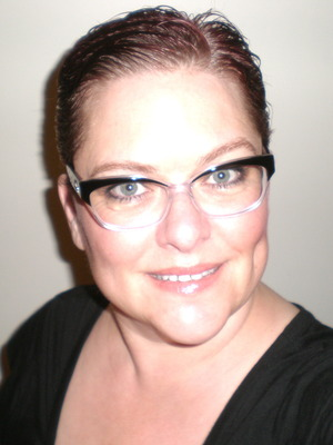 Me with short hair and glasses