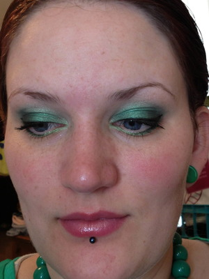 I like a nice spring green for my blue eyes.  I really like coordinating the color of my eye shadow with my clothes and accessories, so when I wore this look, I also had my green plugs in with a green top and green necklace.