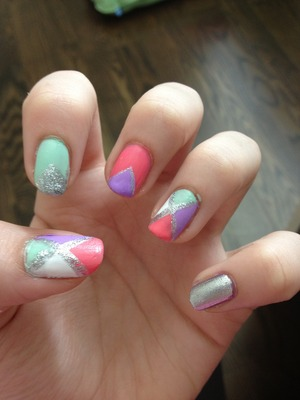 I used pink, purple, white, and mint green. I also used a silver glitter striper. It's really easy!