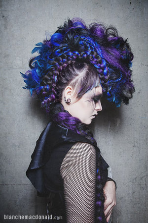 Blanche Macdonald Pro Hair student Poppy Dombrowski delved into her roots, whilst staying true to her love of the fringe state of mind with this phenomenal braid and feather Avant-Garde mohawk!