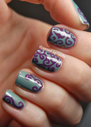 All freehanded with a tiny detailing brush. Colors are butter LONDON Two Fingered Salute and Zoya Tru, both of which are incredible in person and you guys need them. :)  http://www.dressedupnails.com/2013/01/shimmery-swirly-turquoise-purple-nails.html