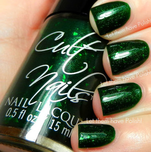A glowing emerald jelly with green flakes. Behind Closed Doors Collection