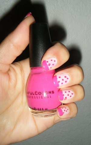 Baby pink base, red dots and bright pink tips. Can't see it too well but also have a Jordana glitter polish on top, it has big hearts but only one brushed on on my ring finger.
