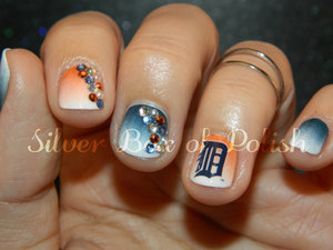 Nail art inspired by the Detroit Tigers.