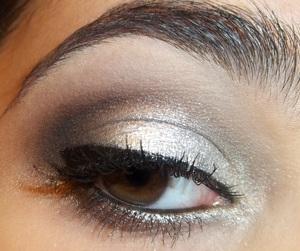 Very metallic silver eye with a dark, dramatic crease.