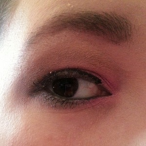 Pink and brown eye makeup with thin black liner.