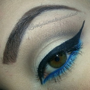 dramatic wing with a pop of blue
