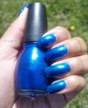 Two coats of Sinful Colors Midnight Blue. A gorgeous dark blue with a slight baby blue shimmer.