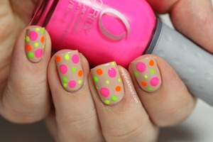 OPI Don't Pretzel My Buttons with neon dots from ORLY Feel The Vibe and green from American Apparel. Used dottingtools in 4 different sizes.