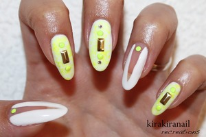 """The """"deep v cut out nails"""" are inspired by Nina Nailed it.  ♡ Products I used ♡ """"Sun- Kissed"""" by China Glaze (neon yellow) Nr. M103 by f.flormar (white) Round studs: http://www.bornprettystore.com/200pcbag-neon-round-stud-rhinestone-acrylic-nail-colors-p-6494.html  Long studs: http://global.rakuten.com/en/store/harukastore/item/10000130/ Base and top coat"""