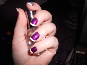 I've been dabbling around in nail art as well... Just a simple fun french tip. Silver accent nail with the same tip, and two little... swipey type things on the thumb... not that you can see that. TT^TT