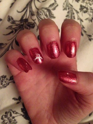 Red glitter shellac nails with a reindeer detailing